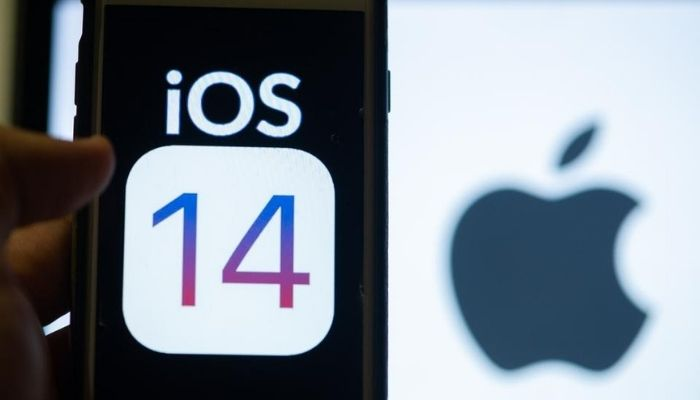 iOS 14 phone update in hand